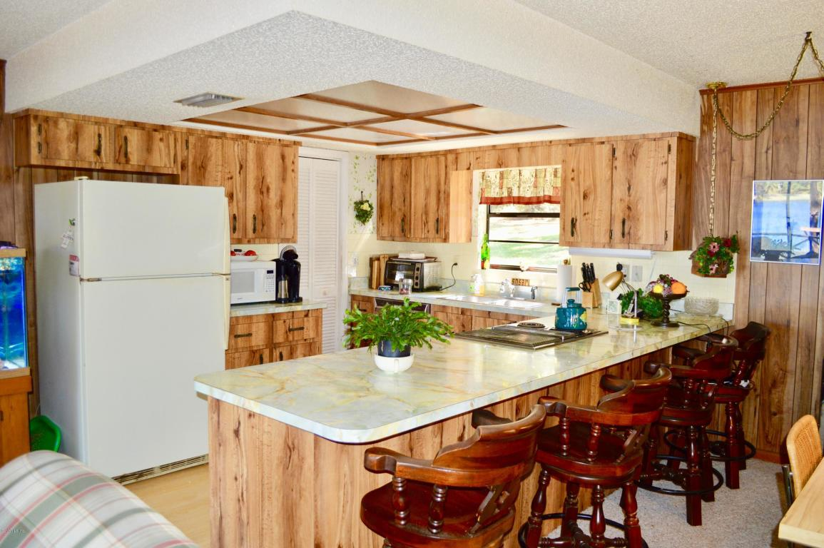 open rustic kitchen with breakfast bar