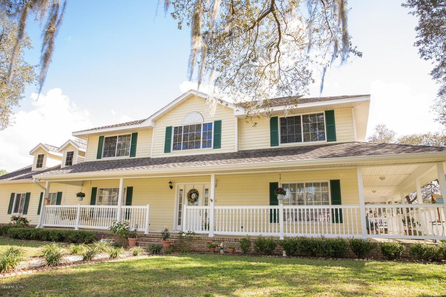 two story farmhouse with wrap around porch