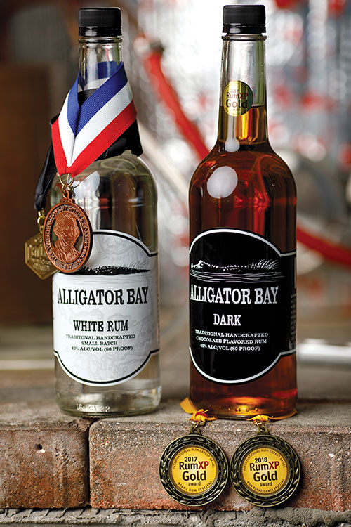 alumni-pg44-rum-distiller-bottles-500x700.jpg