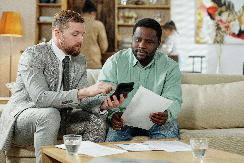 diverse-men-calculating-loan-rate-AWEYJTR.jpg