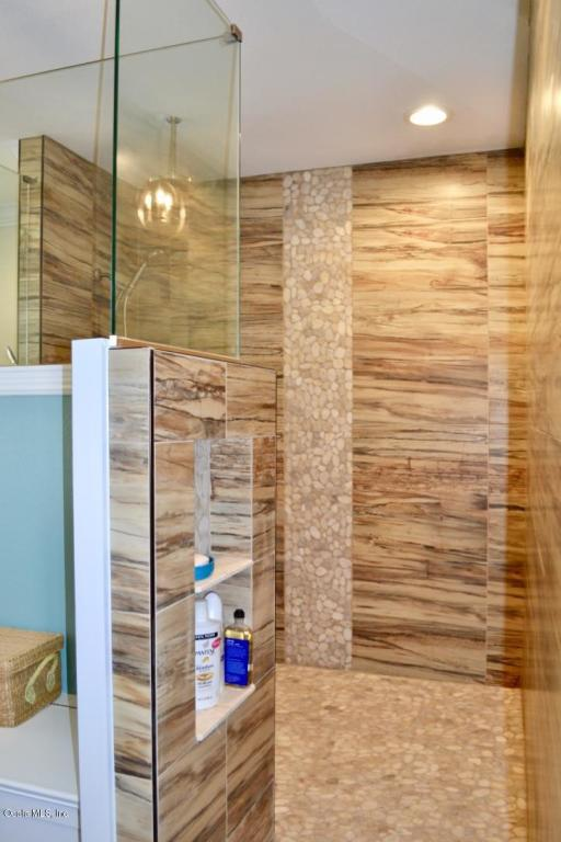 large renovated walk in stand alone shower