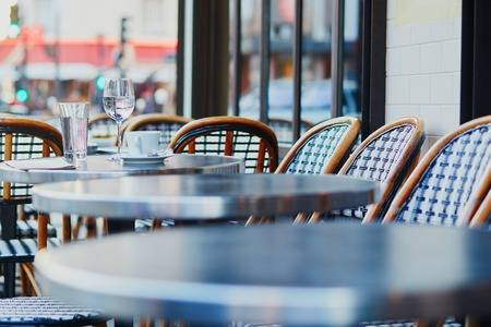 93856608-empty-coffee-cup-and-glass-of-water-in-an-outdoor-cafe-in-paris-france.jpg