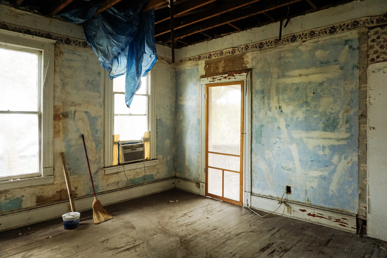 brown-broom-and-white-plastic-bucket-3562689 stripped room.jpg
