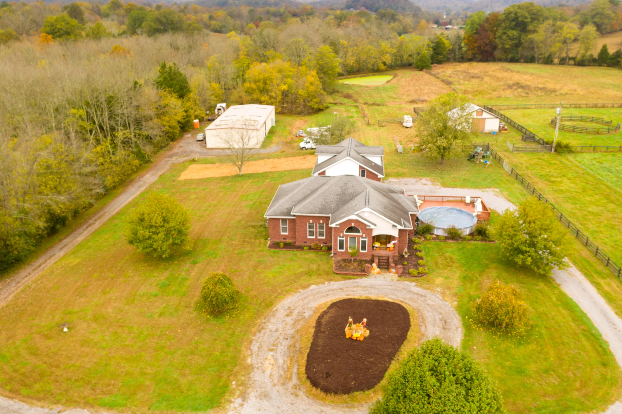 Custom Built Brick Home On Over 6 Acres With Barn And Pond!  1945 Upper Station Camp Creek Rd., Cottontown, TN.  37048