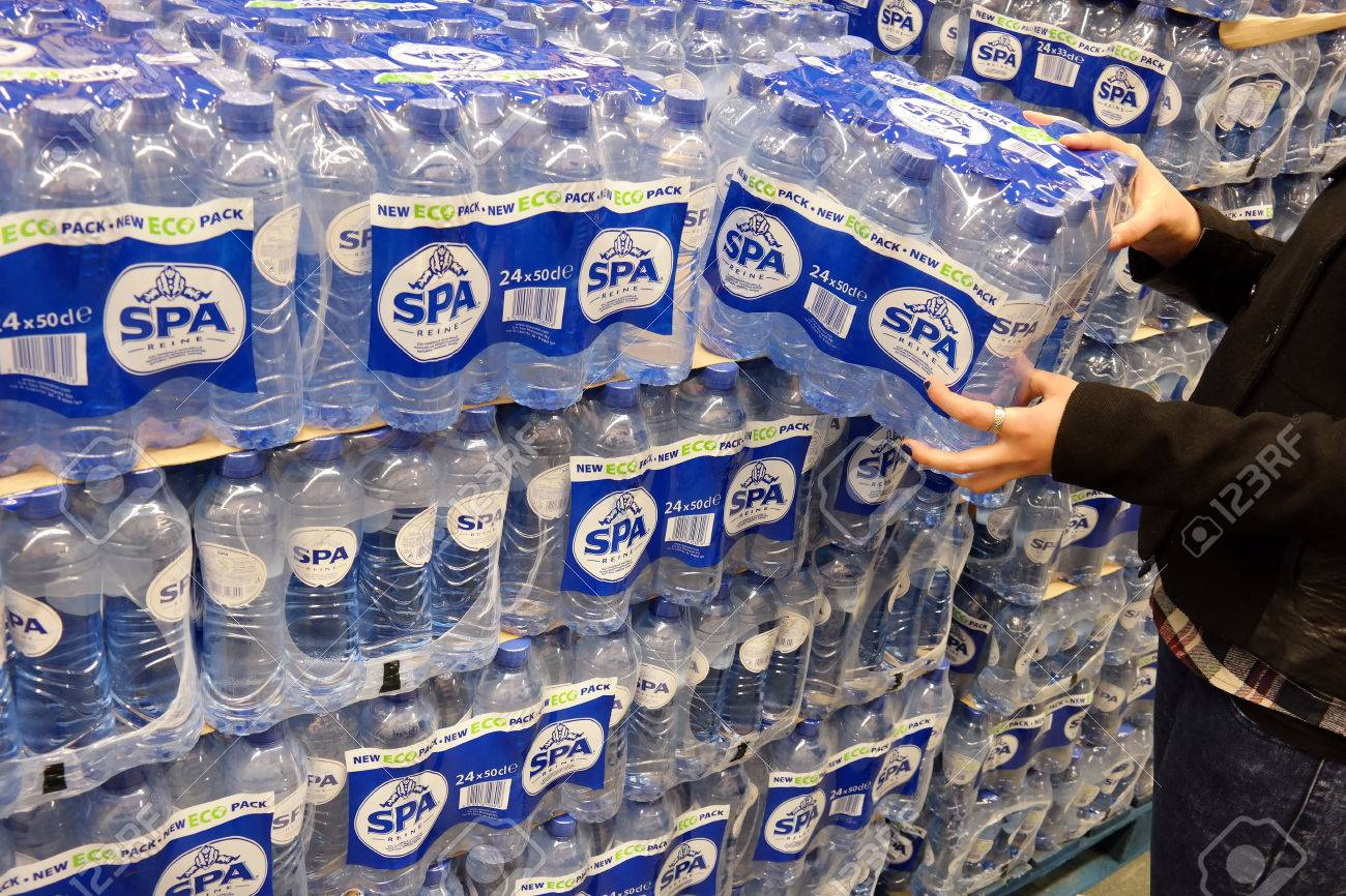 38714851-the-netherlands-march-2015-stack-of-with-24-packs-of-shrink-wrapped-spa-reine-water-bottles-in-a-who.jpg