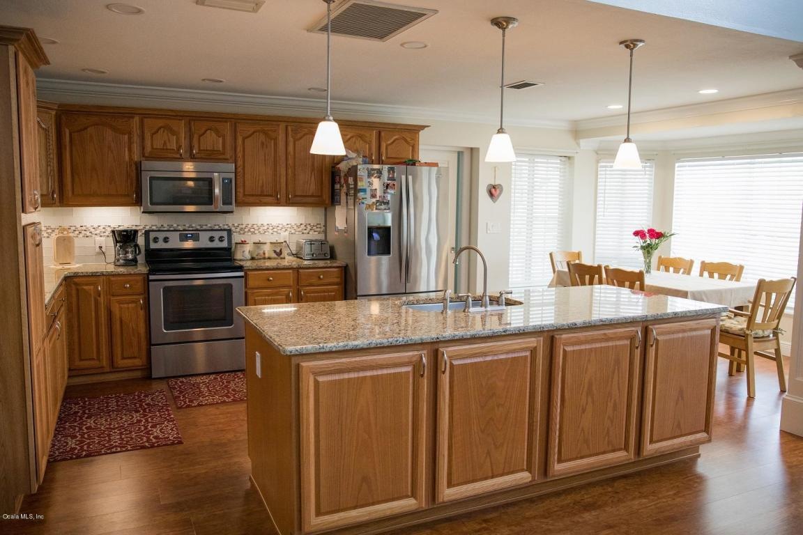 renovated open kitchen with granite and a large island
