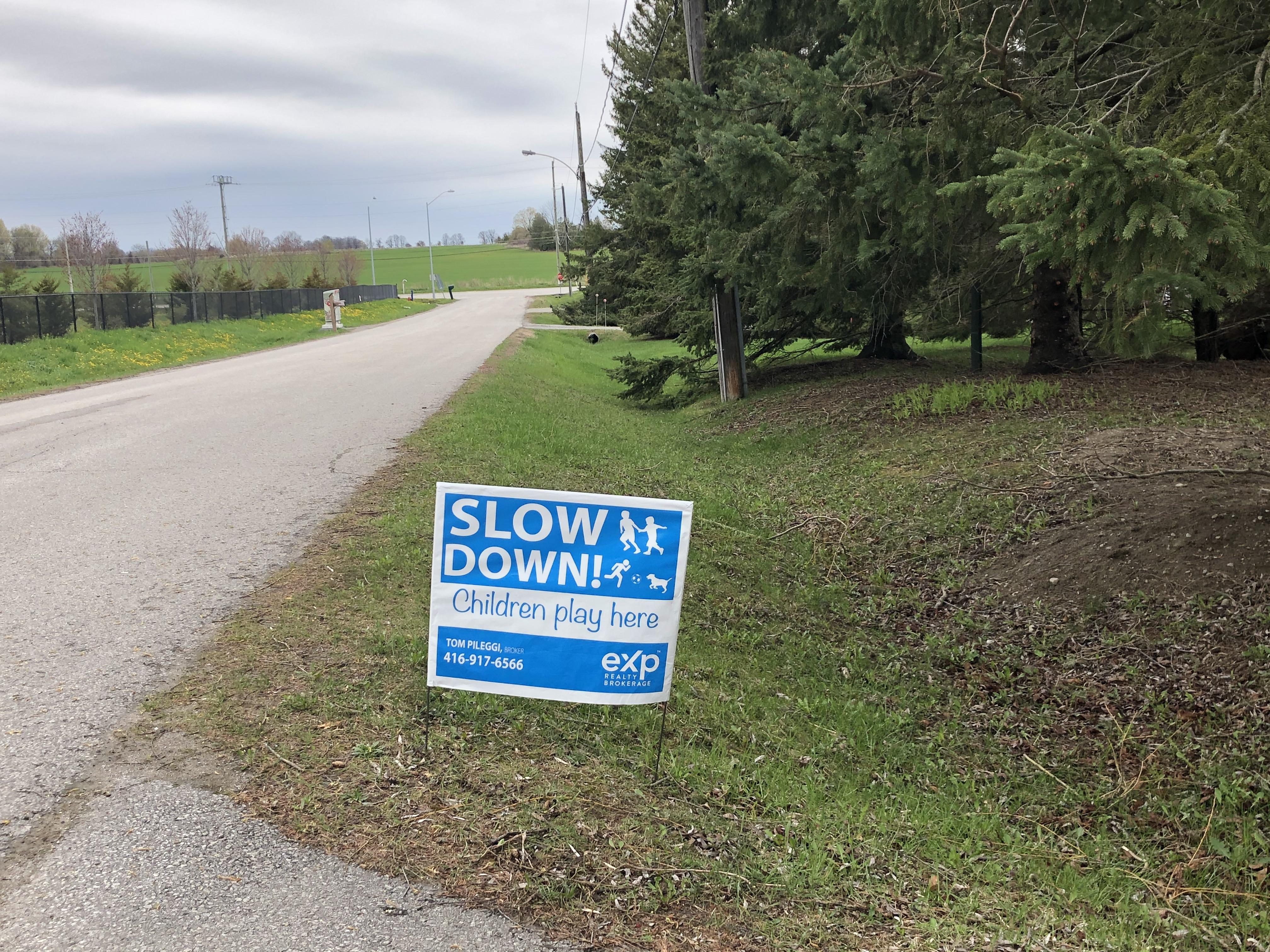 Slow Down Sign.jpg